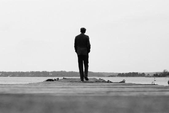 Man walks away along the jetty