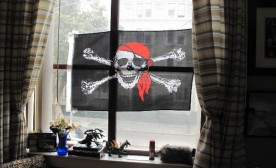 Window with pirate flag, Maitri Compassionate Care