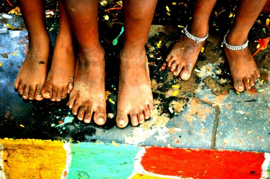 People's feet in an slum in India