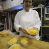 Chef Pauline Gillam puts the final touches on Cod au Gratin