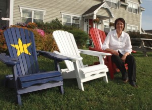 Pauline Bona in front of her Inn, Arichat, Cape Breton