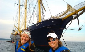 Two sailors, with the Caledonia in the background