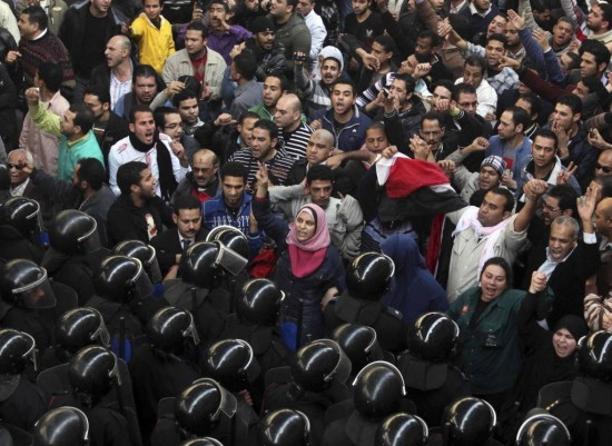 Egyptian protesters face anti-riot policemen today in Cairo. AP Photo