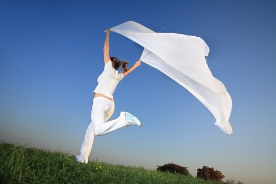 Woman running and jumping outdoors