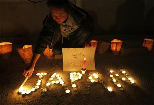 Lighting candles for Japan