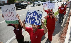 Teachers and other opponents of the merit pay legislation protest in a walk from Lee Middle School to the CTA/OESPA office in Orlando on April 8, 2010. (JACOB LANGSTON, ORLANDO SENTINEL / April 8, 2010)