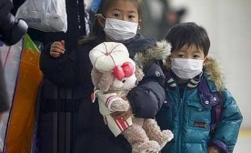 Young children in Japan wearing face masks