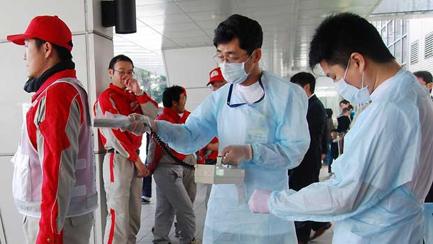 Technicians scan Red Cross rescue workers for signs of radiation in Nagahama City, northern Japan, on Monday. A European bone marrow group is offering to help care for nuclear plant workers exposed to dangerous radiation. (Kyodo/Reuters)