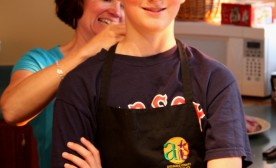 A mom helps prep her chef son for cooking