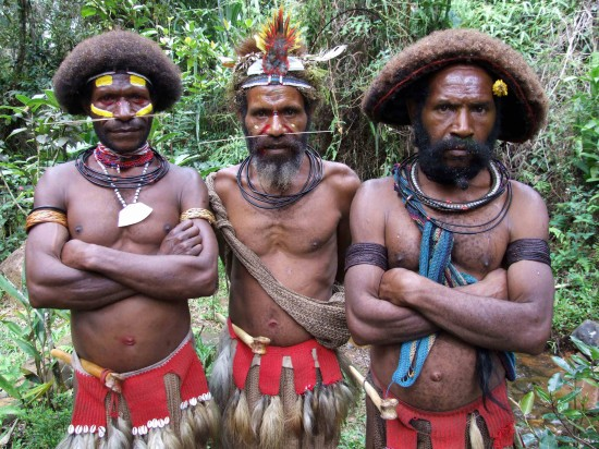 A Huli Wigmaster with his charges, New Guinea.