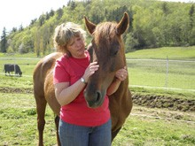 Lorna stands with Penny who's a combination of gutsy and gentle. She's unwilling to give in quietly to horses that try to take her food, yet she is gentle with children and teaches them to build confidence. Courtesy of ANT