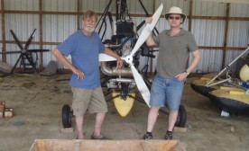 Bill Lishman and George Burden in front of one of Bill's ultralights