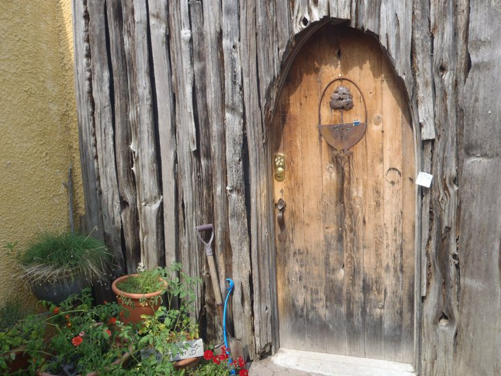 "Front door of ""Father Goose's"" eco-friendly underground home."