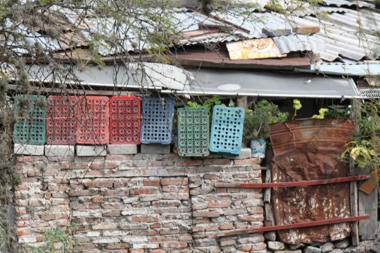 Building with what is available. Plastic crates. Wire. Old iron bars. Bricks. Tin.