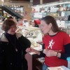>> Emily Forrest of Local Tasting Tours giving a guest some pointers on  Italian gelato