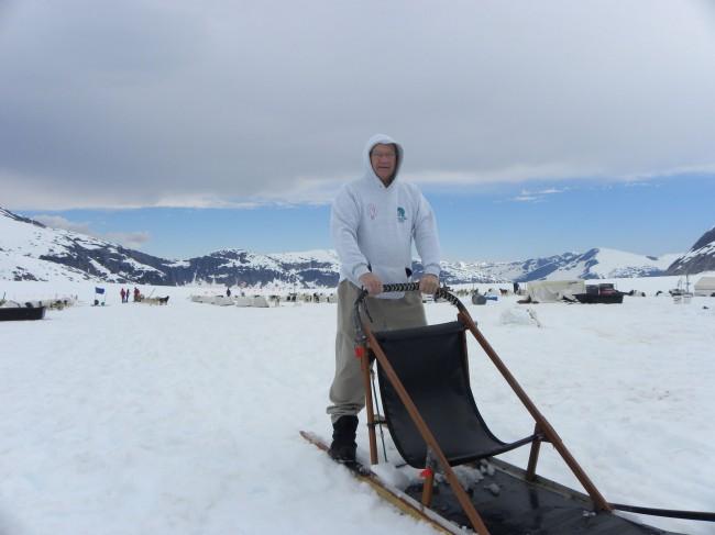 Eugene Burden mushes sleigh