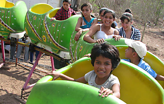 First-time carnival ride for Rosario, an orphan at Angelitos Felices