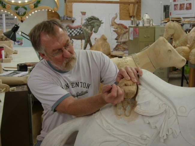 Lead carver Jack Giles at work