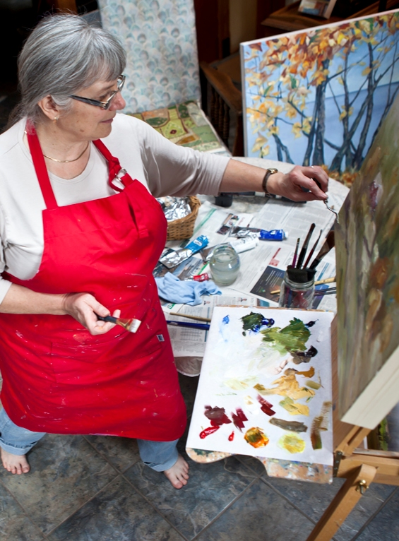 Artist Terrill Welch painting in her studio  by photographer Allison Mullally