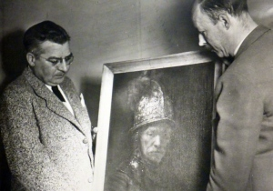 Heinrich (right) and an unidentified colleague examine what in 1949 was believed to be one of the most valuable paintings in the world, Rembrandt's Man With A Golden Helmet. It was hidden in a salt mine before being recovered by the Americans. In 1985, it was reclassified as painting done by a student of Rembrandt's. (University of Regina archives)