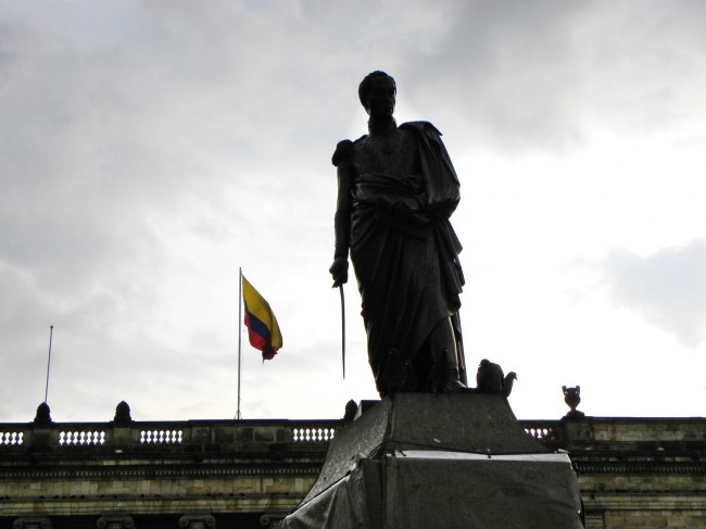 Statue of Simon Bolivar, South America's liberator with Colombian flag and National Capitol behind