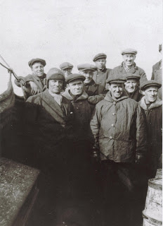 Photo of Captain Eugene Burden, third on the right in the back row.