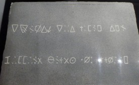Replica of a mysteriously inscribed stone found within the Oak Island money pit.