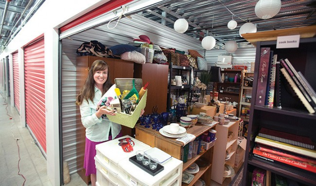 Anney Ardiel, shows off Anney's Closet, one of four locker storages full of donated items given free to women in need of household items to start up new homes and new lives.