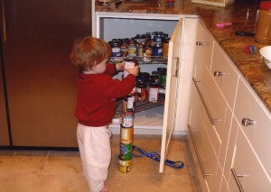 Quinn, an 18 month old boy with autism, obsessively stacking cans.