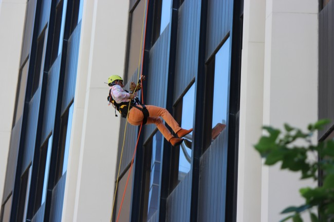 Riaz Mamdani rappelling down a downtown high-rise in Calgary.