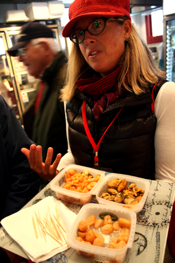 Chef Stephanie Brewer offers samples of sustainably farmed smoked shellfish in Portland Maine.