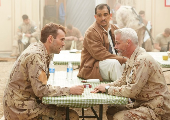Warrant Officer Ryan Sanders (Rossif Sutherland), The Cleaner (Nabil Elouahabi) and Captain Pete Mitchell (Paul Gross) discussing an upcoming military operation.