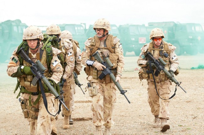 Canadian Armed Forces (CAF) soldiers on foot patrol.