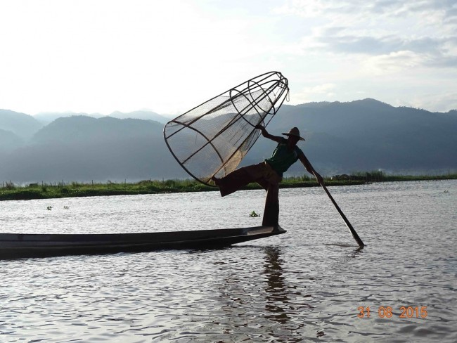 A fisherman with his net and pole
