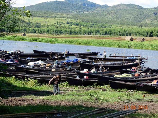 Boats coming ashore near a farmer's market
