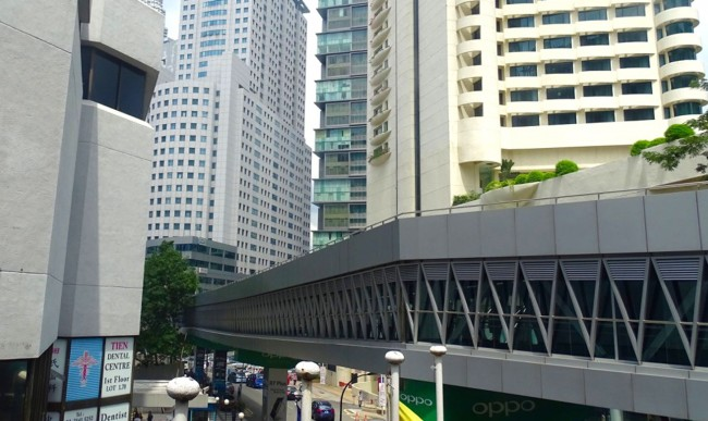 An air-conditioned skywalk connecting a transportation hub and the Petronas Towers