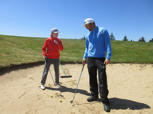 Bradlee Ryall golf, and junior golf lesson in the sand trap © Rob Campbell