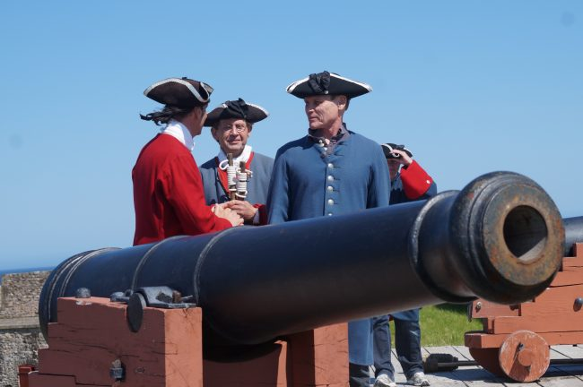 Preparing to fire an 18th Century French cannon.
