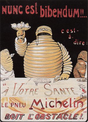 circa 1898 - The first depiction of the Michelin Man making a toast. He is also known as Bibendum, possibly because of this poster. The phrase Nunc est Bibendum! is taken from the Odes of Horace.
