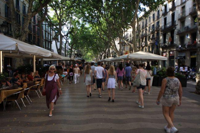 Tourists and locals strolling on La Rambla