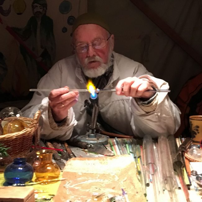 Christmas glassware being handmade by a 90-year-old glassblower, the oldest craftsman at Wartburg Castle. All gifts sold at Wartburg Castle are handmade locally with the exception of one international craftsperson who is invited to attend.