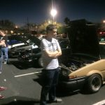 At a car meet, admiring the scenery.