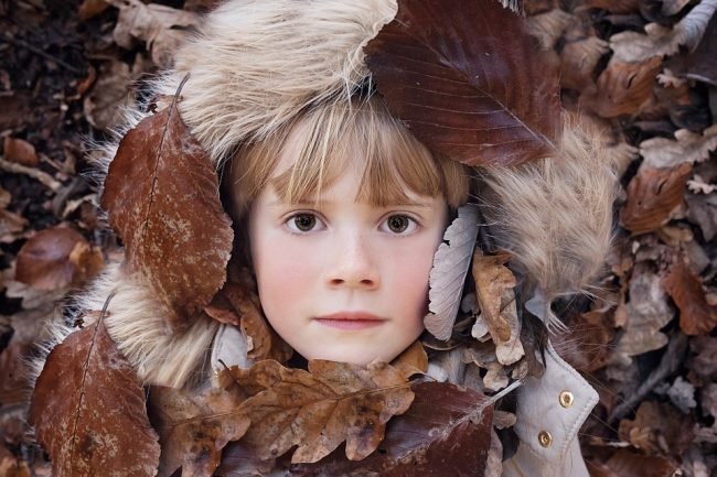 Child in leaves