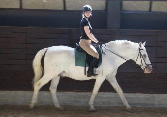 Ari riding her stallion, Rudy