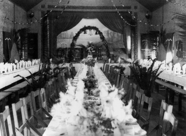 Grand hall set for a wedding in the 1940s