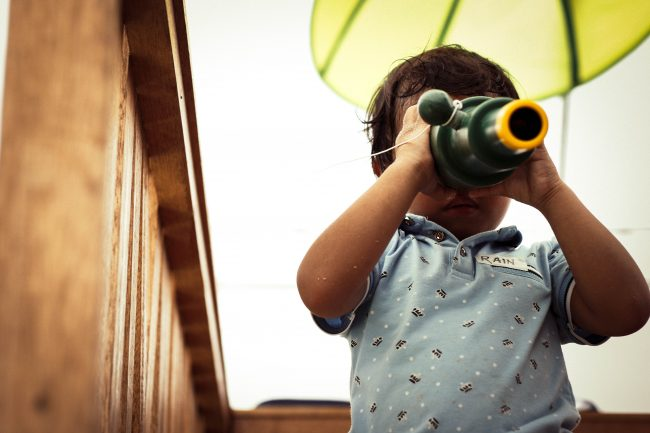 A child with a toy telescope