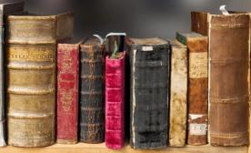 Closeup of very old books on a shelf
